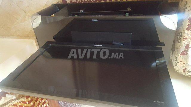 Téléviseur avec table noir   - 1