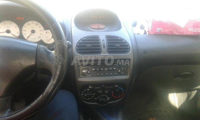 Voiture Peugeot 206 2009 au Maroc  Essence  - 6 chevaux