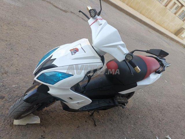 moto scooter dokker mod 2017 makina rigalo jabon  - 2