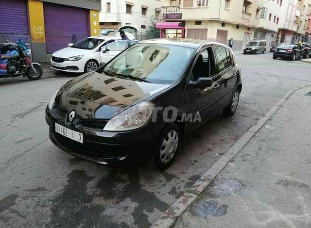 Clio III premier main - 4