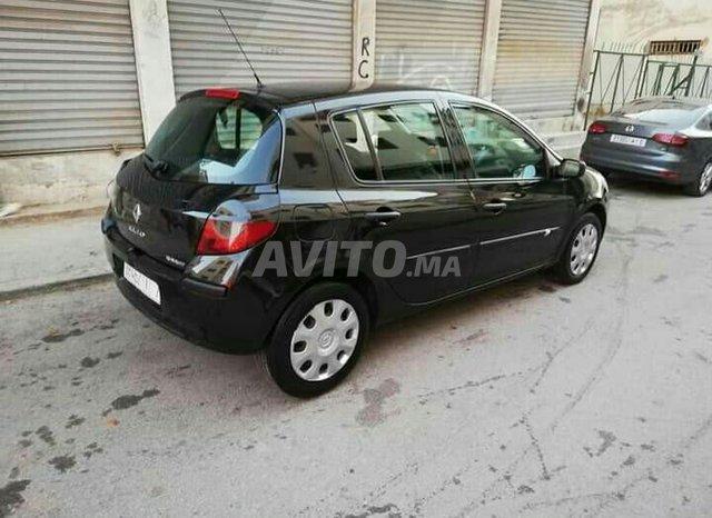 Clio III premier main - 6