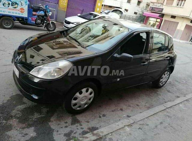Clio III premier main - 7