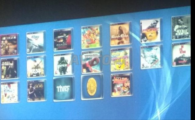 PS3 Slim 500 GB/61 jeux/2 manettes sf/3 cables - 7