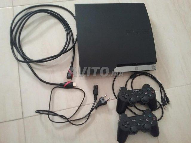 PS3 Slim 500 GB/61 jeux/2 manettes sf/3 cables - 1