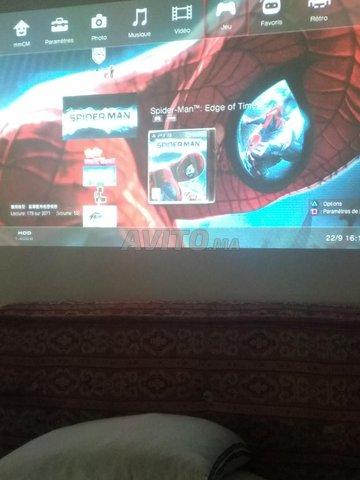 PS3 Slim 500 GB/61 jeux/2 manettes sf/3 cables - 6