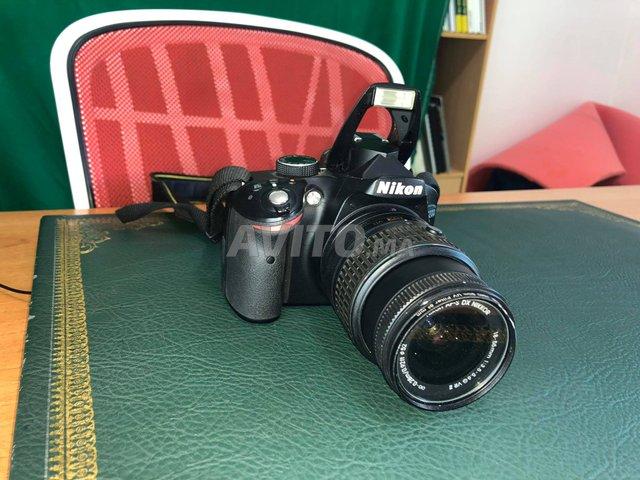Nikon D3200 avec Objectif AF-S DX 18-55 mm Noir - 1