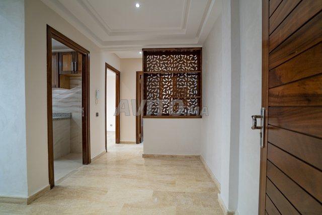 Appartement  de 123 m2  en RDC avec cour  - 1