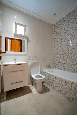 Appartement  de 123 m2  en RDC avec cour  - 3